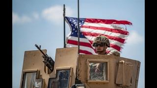 Russian patrol passing by Americans east of Qamishli, Syria
