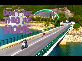 Paraglider tow by a motorcycle on a bridge. Don't Try This At Home N°4