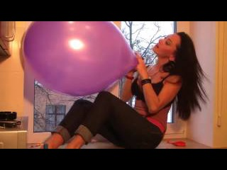 Hot girl blow to pop big balloons